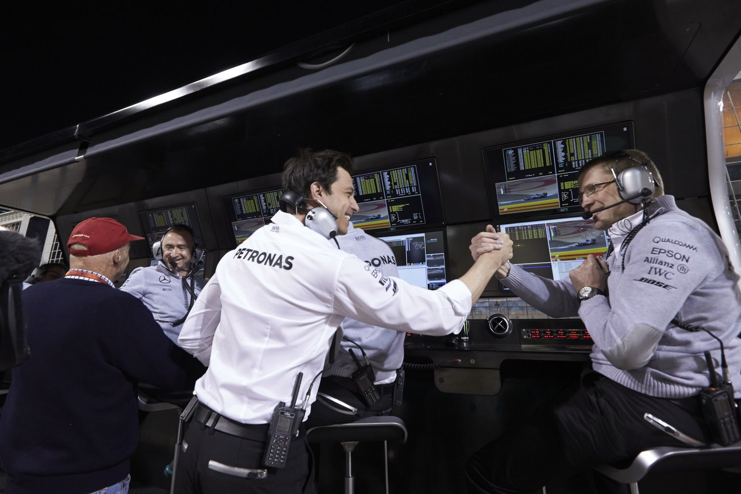 A happy Toto Wolff congratulations one of the Mercedes engineers