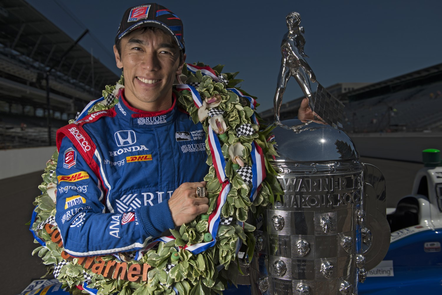Sato with Borg Warner Trophy he will not get to keep. The winner gets a Baby Borg that is small and cheap.