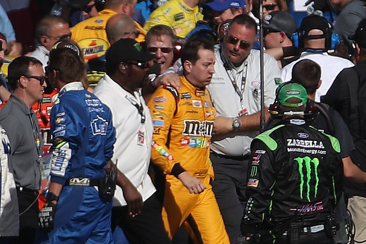 Kyle Busch is escorted away