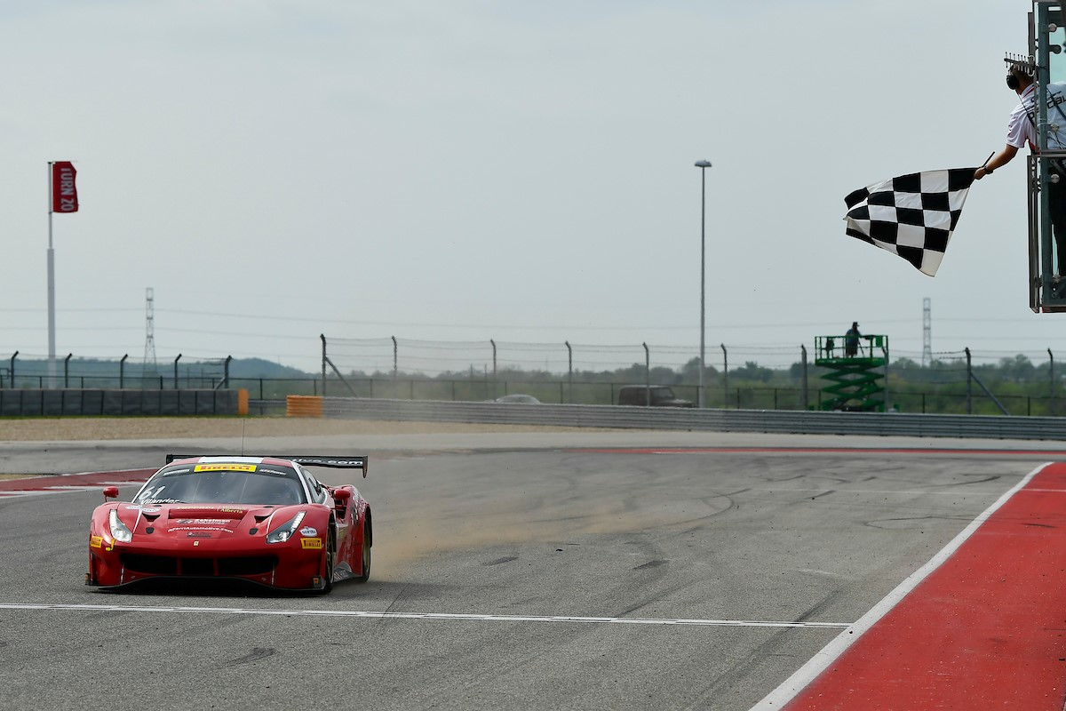 The Ferri Motorsport Ferrari takes the flag