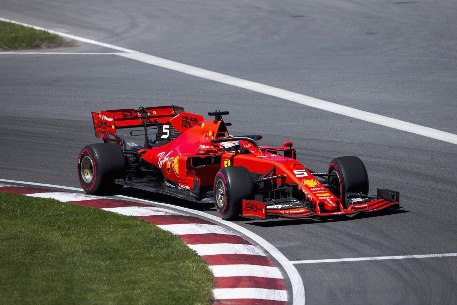 Sebastian Vettel gave the Ferrari fans something to cheer about with a rare pole for the Scuderia