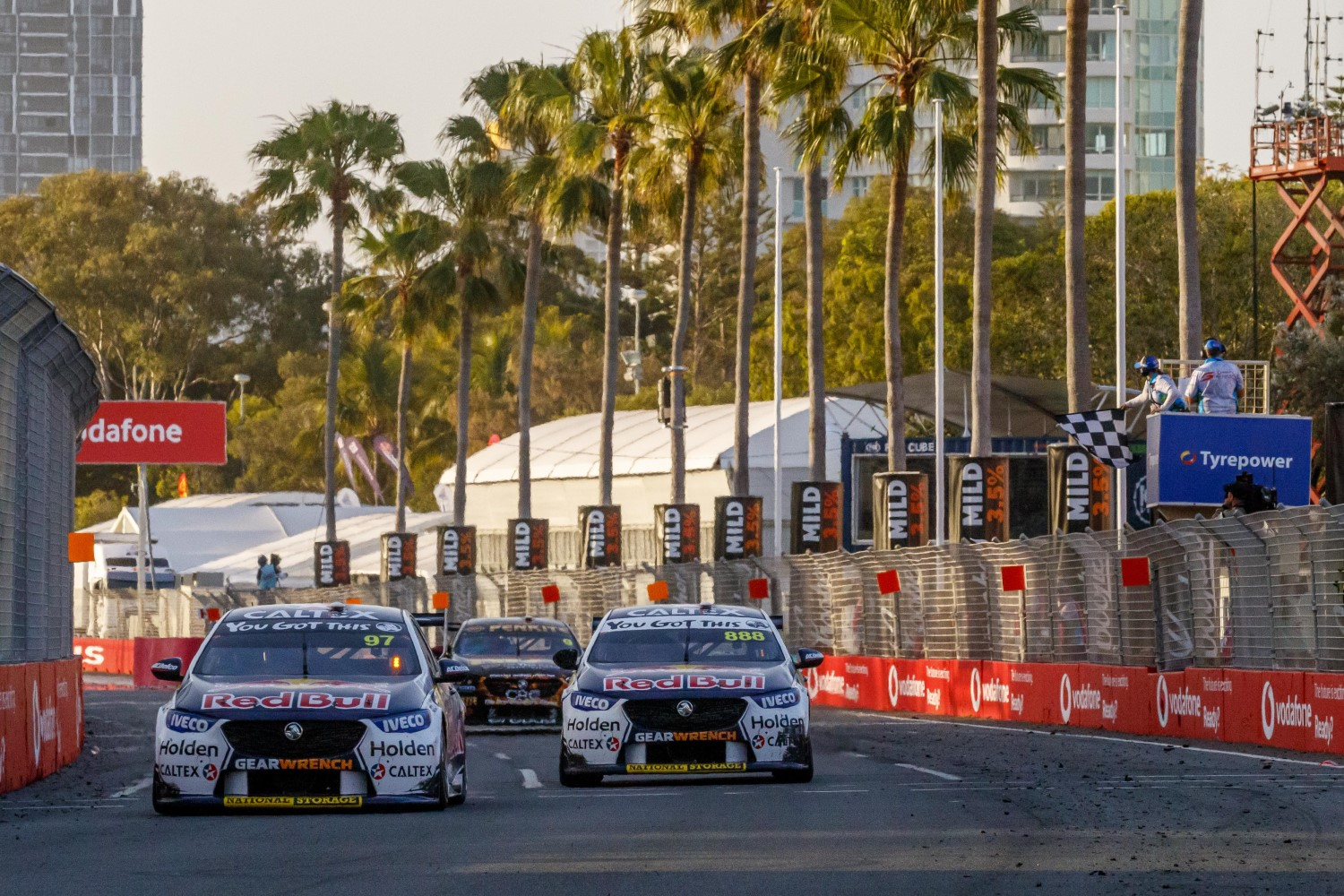 van Gisbergen leads the sister Red Bull Holden of Lowndes across the line in a close finish