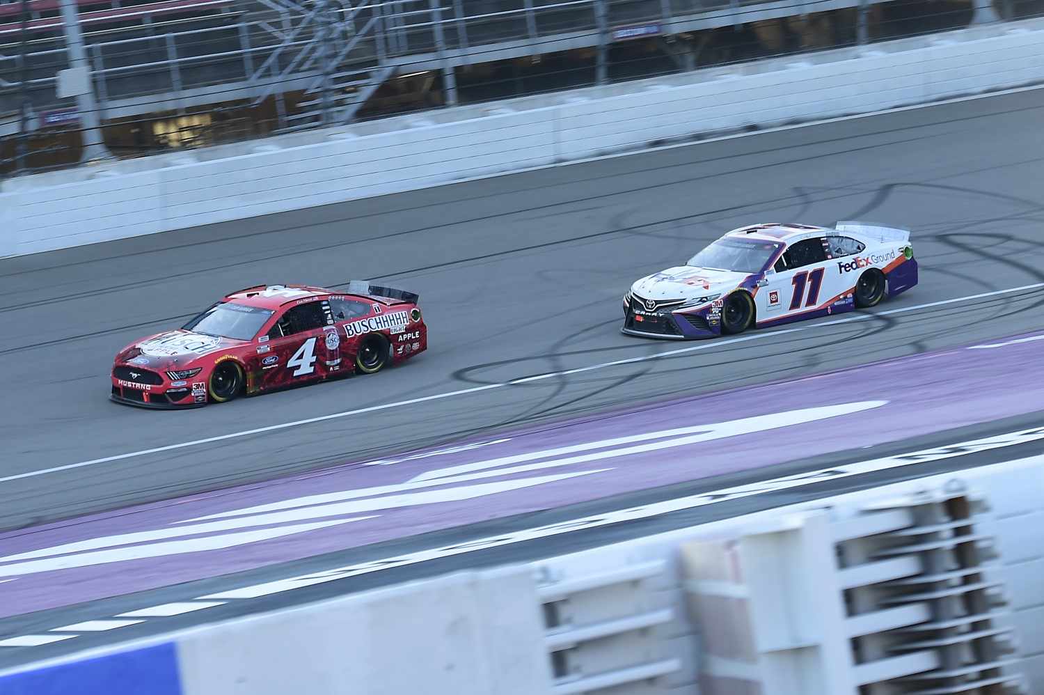 Harvick battles Hamlin for win
